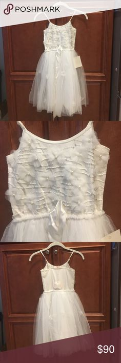 Tutu du Monde XO dress NWT size 8/9 Tutu du Monde girls size 8/9 XO dress. NWT. Too has sequins, beads, and tulle flowers. Bottom is soft tulle that falls below the knee. Bottom has same tulle flowers with pearl centers. Cute for flower girl dress, weddings, or family pictures. tutu du monde Dresses Formal