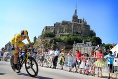 Chris Froome racing in a time trial stage in the 2013 Tour de France with Mont Saint-Michel in the background. The 2016 Tour will commence from the Mont. Tony Martin, Chris Froome, Stage, The Mont, Mont Saint Michel, Pro Cycling, Big Dogs, Trials, Trek