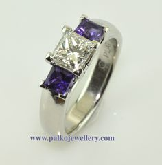 Platinum Ring with 0.71ct Canadian Diamond, Princess Cut Centre with 3.5 mm Princess Cut Amethysts side stones. Simply sensational ... and she did say YES!