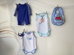 Pinned cute on theme colour baby clothes to fish netting