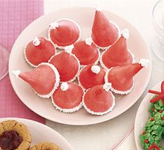 Santa Caps --  Turn meringue into a festive treat with food coloring and white chocolate.