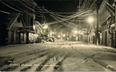 Franklin Street, in downtown Juneau, is pictured on a winter night in the early 1900s.