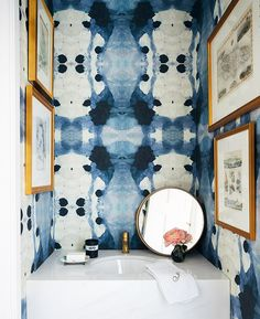 "A blue and white watercolor wallpaper lends this modest powder room a moody envelope. And for homeowner Genevieve Makinson, the pattern has a bit of an edgy side, too: ""If you look closely, the pattern resembles skeletons! Chic Bathrooms, Dream Bathrooms, Scandinavian Bathroom Inspiration, Powder Room Decor, Powder Rooms, Watercolor Wallpaper, Blue Wallpapers, White Rooms, Decoration"