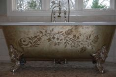 Clawfoot tub with raised modello, gilded  and glazed.