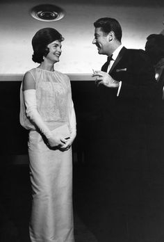 1961: Jacqueline Kennedy   More detail of the First Lady Jacqueline Kennedy's dress as she stands chatting with her brother-in-law, actor Peter Lawford. (Photo by Paul Schutzer/The LIFE Picture Collection/Getty Images)  via @AOL_Lifestyle Read more: https://www.aol.com/article/lifestyle/2017/01/18/first-ladies-inauguration-ball-gowns-50-years/21657651/?a_dgi=aolshare_pinterest#fullscreen