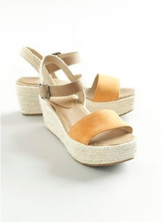 EILEEN FISHER MAKES SHOES!!! This wedge sandal is the yummiest, softest, most comfortable, beautiful neutral colors, very cool, love the rope-covered heel, fabulous summer shoes! Perfect with wide leg trouser jeans and with dresses! And with skinny jeans and dolman tees, also with a-line skirts and a knotted up plaid boyfriend shirt...hmm, not enough days in the year to wear these with everything! xo