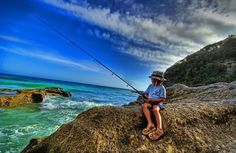 Boy fishing Wallpaper