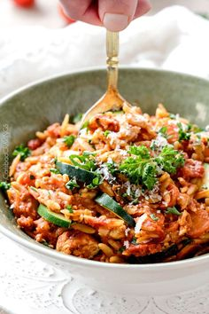 ONE POT Italian Chicken and Orzo (and veggies!) in a creamy Parmesan tomato sauce on your table in just over 30 minutes and all made in one pot!