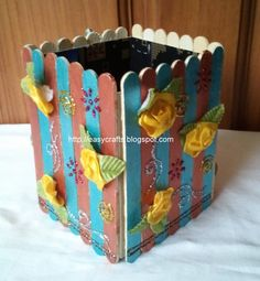 ICE CREAM STICK CRAFTS   Pen stand made with icecream sticks and decorated with fabric colours ...