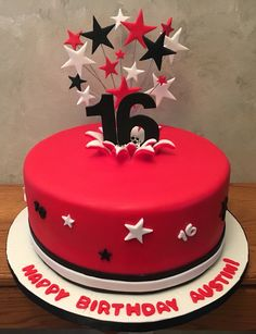 Red black and white birthday cake, numbers exploding from cake