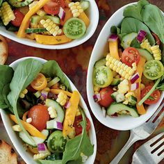 Create a colorful and healthy salad by combining mango slices, tomato, cucumber, corn and basil and a lime vinaigrette, then tossing with...