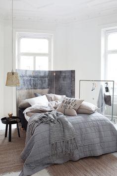 soft grey bedlinen and screen