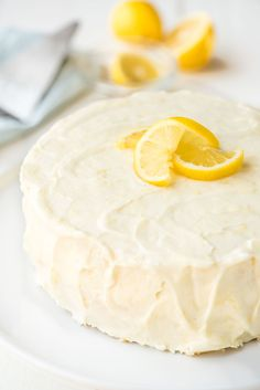 Supremely moist and fluffy lemon layer cake with homemade lemon cream cheese frosting. Every bite bursts with fresh lemon flavor, and it's easy to make too!