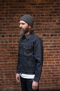 Made from our exclusive 16.5 oz Cone Mills White Oak Selvedge Denim with two exterior side pockets and two interior pockets