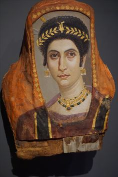 Mummy Portrait of Isidora, Romano-Egyptian, about AD 100. Encaustic and gilded on wood; pigment and gilding on linen. Attributed to the Isidora Master. Getty Villa, Malibu, California. 2017