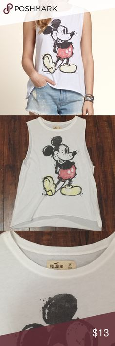Mickey Mouse muscle tee Hollister Mickey Mouse muscle tee size XS. Worn once.perfect for a sunny day in the parks! Hollister Tops Muscle Tees