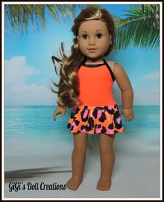 Neon and animal print ruffled swimsuit by GiGisDollCreations on Etsy. Made following the Wild Waves One-Piece Skirted Swimsuit pattern. Get it here http://www.pixiefaire.com/products/wild-waves-one-piece-skirted-swimsuit-18-doll-clothes-1. #pixiefaire #wildwavesskirtedonepieceswimsuit