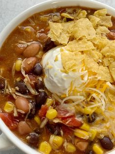 7 Can Chicken Taco Soup Recipe - Dinner does not get any easier than this 7 can chicken taco soup! Dump 7 cans into a pot plus some seasonings and that's it! Serve with tortilla chips, cheese, and sour cream. You won't believe how yummy & easy it is. Can Soup Recipe, 7 Can Soup, Easy Soup Recipes, Cooking Recipes, Keto Recipes, Chicken Recipes, Taco Recipe, Recipe Chicken, Diabetic Recipes