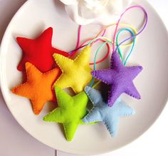 Rainbow Stars Felt Christmas Ornaments Let us help you make your own christmas decorations at our weekly Stitch Classes in Brighton & Hove http://www.sewinbrighton.co.uk/stitchclasses.html