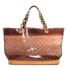This is an authentic LOUIS VUITTON Vinyl Cabas Sac Ambre GM. This casual tote is crafted of Louis Vuitton monogram vinyl in transparent amber brown.