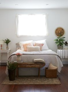 adding a large basket next to the bench you have (I'd go a little taller than the bench and maybe square or rounded) to store extra pillows, blankets etc., helps to fill up the space in a useful way...
