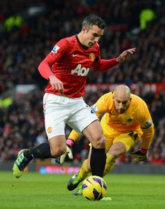 ~ Robin van Persie of Manchester United against Tim Howard of Everton FC ~