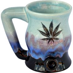 Wake -n- Bake mug and pipe all in one! No cross contamination between your smoke and your favorite drink! Microwave, Oven, Dishwasher and Food Safe! Shown in our Marijuana Leaf design and Mountain Waves Glaze. $70.