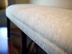 A hall bench, upholstered in soft cotton, provides a spot to stop and reflect or kick off shoes after time spent outdoors.
