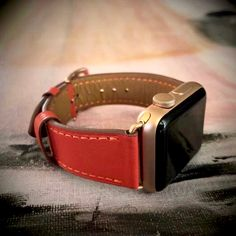 This fire red Apple Watch band is handmade, durable & full of style. Dress up your outfit with this premium strap. You can style it by pairing it with nice jewelry, or you can go for a cute look by wearing it with costume bracelets. This comfortable women's leather strap comes in all hardware colors: silver, gold, rose gold, space gray & black. Compatible with Series 1, 2, 3, 4 & 5, Sport and Hermes Editions. #goldapplewatch #applewatchbandgold #applewatchfashion #applewatchstyle…