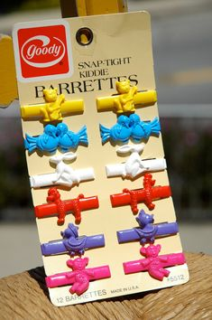Goody snap-tight barrettes. I would typically wear about 10 at once! :)