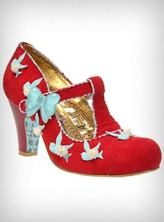 """1930's inspired maryjanes with a twist! Made of cherry red faux suede and red leather-look vinyl adorned with light blue plastic birds and white plastic roses, these gorgeous pumps from Irregular Choice feature rounded toes, maryjane t-straps with a big transparent blue plastic bow at the snap closure, and thick retro 2.5"""" heels"""