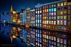 Amsterdam at night. The reflection is awesome. I wanna go to Amsterdam. Places Around The World, Oh The Places You'll Go, Places To Visit, Around The Worlds, Puerto Vallarta, City Photography, Amazing Photography, Photography Lighting, Adventure Photography