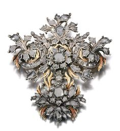 DIAMOND BROOCH/ PENDANT, LATE 18TH CENTURY.    Of foliate design, suspending a pendant of similar design, set with rose diamonds, later brooch fitting, French import marks, fitted case, Mallett.