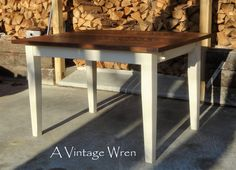 """Custom built farm table, made in New Hampshire. Eastern White Pine top in circular sawn finish stained in Walnut. Custom made tapered (Shaker style) legs, with a chunky taper only on the bottom 2/3rds, painted in Antique White. This table is from our """"Heirloom Collection"""" https://www.facebook.com/AVintageWren"""