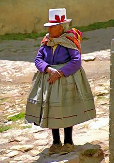 Woman in traditional clothing in Cusco, Peru