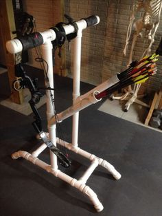 PVC bow stand.  This was my son's 4H project last year.  He made it tall for longer bows as well (such as traditional recurves).