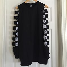 LAZY OAF Armless Sweatshirt Sold out sweatshirt by Lazy Oaf. Cut out details on arms and can be worn as a sweater dress. In like-new condition. Lazy Oaf Tops Sweatshirts & Hoodies