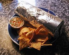 SF MIssion burrito - Plate with foil-wrapped burrito, chips and salsa