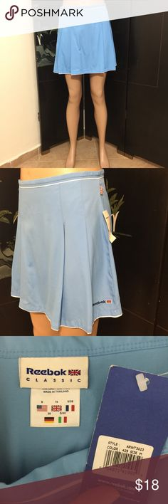 REEBOK Athletic Baby Blue Tennis Skirt M 6 8 NWT Label- Reebok Classic Style-Athletic Skirt, zips at side, one button thin waistband closure. No lining, no attached short. Just a skirt.  Color-Baby Blue, White trim Fabric-100% Nylon Polymide  Size-Label says S but Tag says M. It is a Medium. Shown on a size 4 mannequin- Will fit a 6 or 8  Measurements- Waist- 30 Hip-38 Length-16 Conditiron-New With Tags  Origin-Indonesia Reebok Skirts Mini