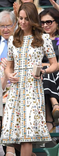Who made  Kate Middleton's clutch handbag, pumps, and print white short sleeve dress? Alexander Mcqueen