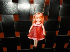 "Liquid resin pendant. ""Red haired doll""."