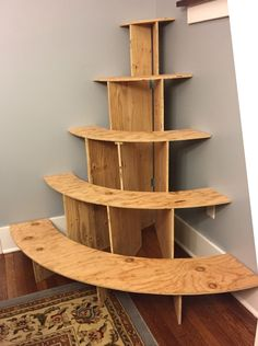 Christmas village corner display stand with curved shelves & hinges for easy folding/storage.