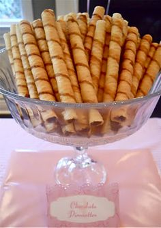 "On a ballerina party dessert table include a big bowl of pepperidge farm pirouettes with a sign that says ""pirouettes"". Girls will love having a pirouette without having to bend all over :)"