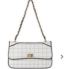 """CHANEL Chocolate Bar Single Flap Chanel Calfskin Chocolate Bar Single Flap Chain Shoulder Bag.  This beautiful bag is the quintessential Chanel handbag. Its lovely bone white color & black trim accented by beautiful gold hardware on the bag & strap. Measures: L 11"""", H 7"""", W 6"""", strap drop 10.5"""". Comes with authentication card & dust bag. This beautiful bag is so stylish and in vogue.....the perfect Chanel to match everything in your fabulous wardrobe. Treat yourself and take it home today…"""