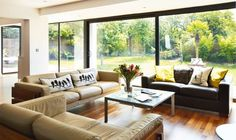 Large windows flood this living space with light