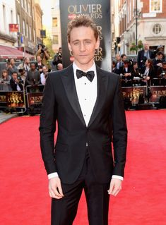 When he felt bad that he couldn't bring you as a date on the red carpet, because it was too soon in your relationship, and didn't want to put you through the media circus just yet.   25 Times Tom Hiddleston Stared Deep Into Your Soul