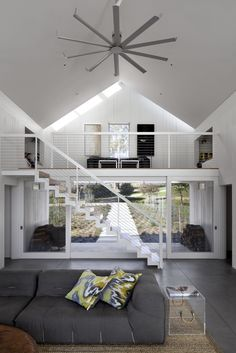 Modern home with living room, sofa, and concrete floor. #TurnbullGriffinHaesloop #interior #livingroom #mezzanine #fan #stair  Photo 5 of Hupomone Ranch