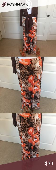 NWOT Susan Graver floral/animal print skirt This very colorful six-panel skirt by Susan Graver is in tones of brown and orange with a brown animal print in the background and vibrant orange flowers. It has an elasticized waist and flares out slightly at the bottom. The matching orange flower shoes are also for sale in my closet🌸 Susan Graver Skirts Maxi