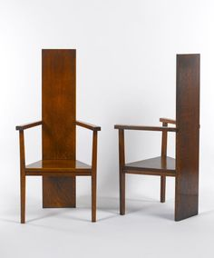 Single plank as both back and legs. Elegant use of material. By Mackay Hugh Baillie Scott.