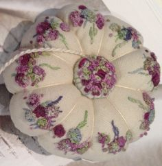 A little pumpkin or tomato style pincushion designed recently  for Cottage Garden Threads Collectors club pattern is available with a subscription to the monthly club contact:Katie@cottagegardenthreads to enquire...